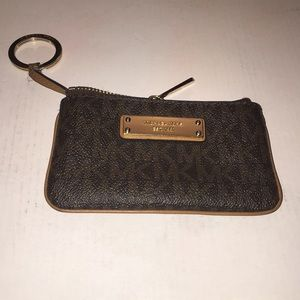 An Authenic MK keychain/card or coin purse